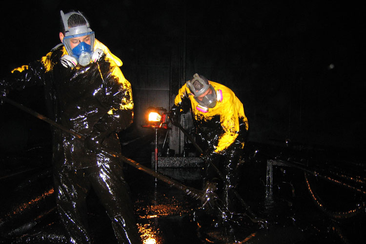 petroleum yank cleaning by hand inside of a petroleum vessel in Contra Costa County